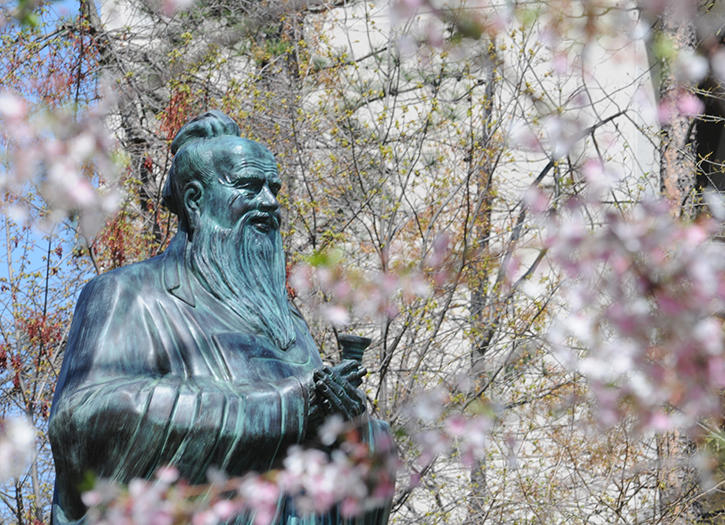 A bronze statue of Confucius on George Mason University Fairfax Campus